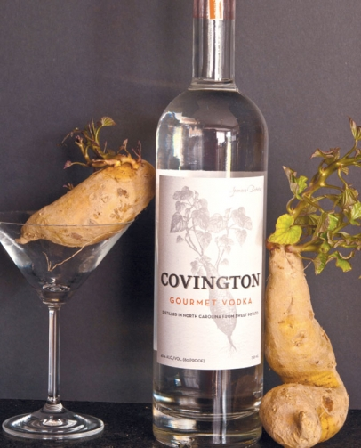bottle of Covington Gourmet Vodka and uncooked sweet potatoes