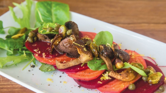 Beet salad with tomato and mushrooms