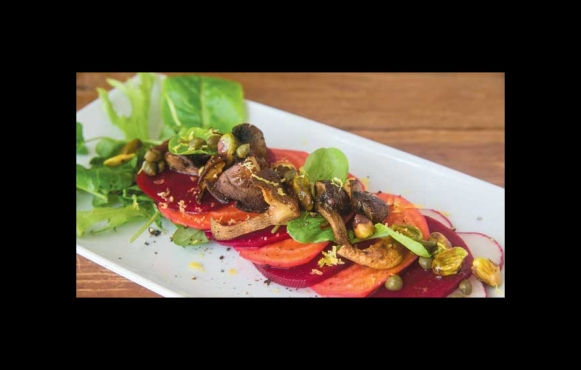 Beet Carpaccio with Roasted Mushrooms, Capers, Pistachio, Radish and Baby Greens
